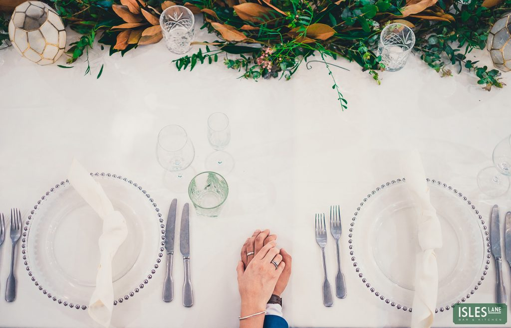 Hands on wedding table